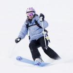 Woman skis in powder snow