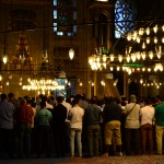 Beautiful lights in the new mosque and people praying