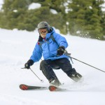 Our guide skis through powder.